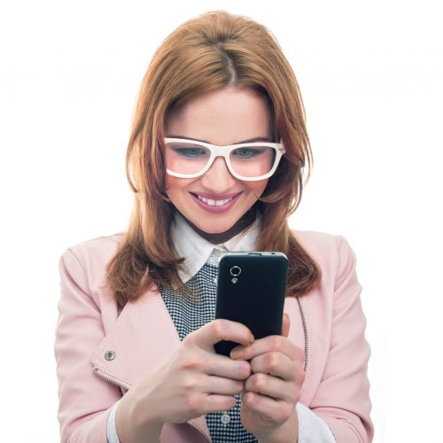 Smile young woman talking on mobile phone, isolated on white. Trendy girl using smartphone, studio shot